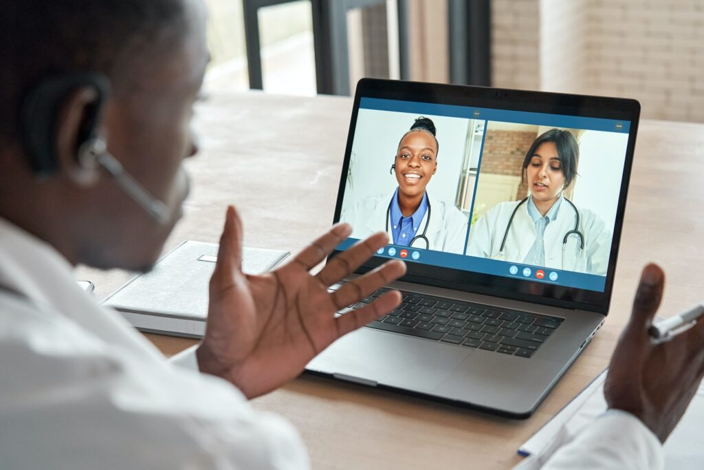 Multicultural doctors team conferencing in video call medical webinar training.